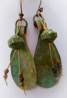 Fun hand forged copper patina earrings with faceted stones and fiber dangles on copper ear wires. Earrings measure 2 3/4 inches from base of ear