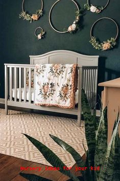 Nursery For Girl With Dark Wall And Flower Rings Accent ★ Colorful and simple nursery ideas for your baby or for twins to feel as comfortable and loved as possible. ★ baby nursery 27 Gorgeous Nursery Ideas To Bring Up Your Baby With Taste For Style Boho Nursery, Baby Nursery Decor, Nursery Room Ideas, Project Nursery, Baby Nursery Ideas For Girl, Baby Nursery Ideas For Boy, Baby Ideas, Simple Baby Nursery, Diy Nursery Furniture