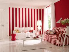 Bright red and white striped walls for living room