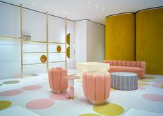 Circular mirrors are fixed within brass frames around the store, and India Mahdavi's 70s-style Charlotte chairs give customers a place to sit and relax in this RED Valentino store.