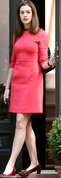 Sixties style: Along with the half-sleeved bright frock, the actress teamed the look with a pair of short red patent leather heels