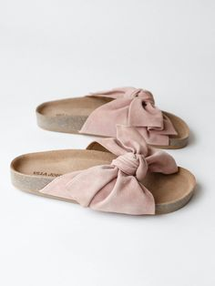 Handmade cork slide with whimsical knotted suede bow. Color- Rose Suede Material- 100% Leather upper, 100% Cork sole Made in Peru