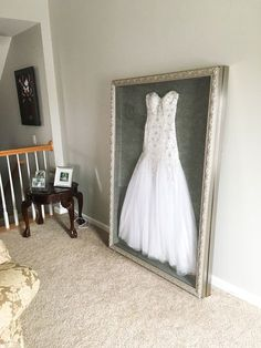 Instead of putting my wedding dress in a box hidden in the attic or possibly sel. Instead of putting my wedding dress in a box hidden in the attic or possibly selling it, I had it shadow boxed to di Wedding Dress Frame, Wedding Dress Display, Wedding Frames, Wedding Dresses, Wedding Dress Shadow Box, Wedding Dress Storage, Wedding Picture Frames, Wedding Goals, Our Wedding