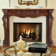 Carved wood mantel dresses up the fireplace - Heat up Your Fireplace with a Stylish Mantel