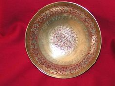 Brass bowl with floral design in center