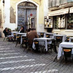 Sidewalk cafe in downtown Lisbon   by Peter Gutierrez. Found on www.flickr.com via Tumblr.