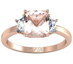 Cushion cut morganite engagement ring with two trapezoid cut diamonds.