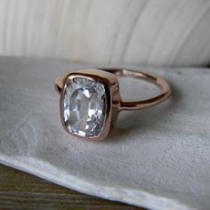 Topaz anyone? 14k Yellow Gold and White Topaz Cushion Shaped Gemstone RIng. $700.00, via Etsy.