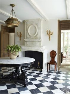 "aestheticinteriors: "" Emma Jane Pilkington's Home The front hall's Indian table and English chandelier and chair are 19th-century, and the 17th-century fire- place is limestone; the marble flooring is by Exquisite Surfaces. Photo: Simon Upton """