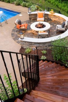 Spiral staircase leading to poolside fire pit