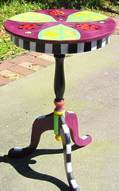 This cute tripod Ladybug table is found at Antiques and Uniques, Palm Harbor Fl.  Art by D Dunbar