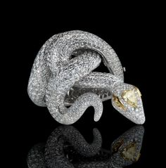 LEVIEV White and Yellow Diamond Snake Bracelet totaling 52.85 carats, handcrafted in 18 karat white and yellow gold.