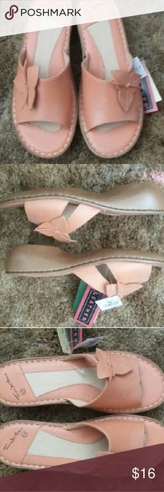 NWT Size 8.5W Peach leather sandals NWT Size 8.5W Peach leather sandals. Clog like style. Flower detail at the toes. Adorable shoes!! Smoke and pet free home.  Make a bundle and save! Sandals Womens Clog Mules Shoes Sandals
