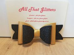 Handmade metallic leatherette and glitter fabric bow