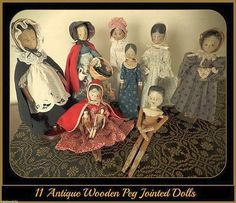 11 Antique Wooden Peg Jointed Wood Dolls German Made