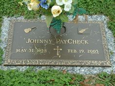 """johnny paycheck gravesite  TAKE THIS JOB AND SHOVE IT""""    COD: Emphysema    BURIAL:  Woodlawn Memorial Park, Nashville, Tennessee      Johnny Paycheck is buried in a part of Woodlawn Cemetery that is owned by George Jones.  Jones donates plots to country singers who are unable to afford a proper burial.  At the time of his death, Johnny Paycheck was penniless and Jones paid for his funeral, his plot, and his headstone"""