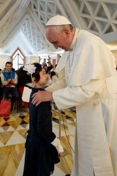 Pope Francis met a group of children battling against cancer at the Vatican on Friday.  Francis prayed with and blessed 22 patients from the Pediatric Oncology department of Rome's Gemelli hospital and spoke with each of them one-on-one.  The children were accompanied by their parents, hospital staff and volunteers who take them on pilgrimages to holy sites such as Lourdes.