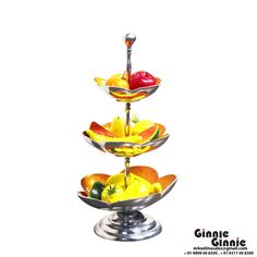 This Ginnie & Ginnie Exclusive Fruit Stand 3 Level is a product from our Home Decor Collection. It is made of Aluminum and it got Paint with Meena finish on it. Its approx LxWxH is 12x12x24 inches. It is of approx 2900 grams. Unique Code of this product is M400077.24