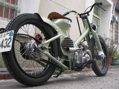 Custom Honda Cub 90... the manliest moped ever. OK, that's faint praise, but it's still pretty darn cool.