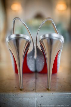 Was looking for an interesting way to show they were Louboutins...I think I succeeded!  #shoes #weddingshoes #bridalshoes #bridesshoes #louboutin #redsole