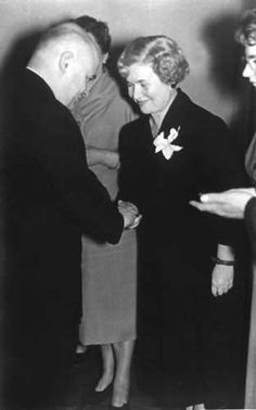 IRENA SENDLER shakes hands with dignitary,