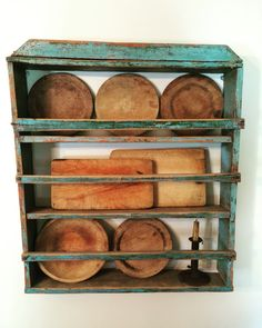 Early plate rack with early treenware.