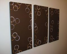 Canvas art with acrylic paints. The trick for making the messy circles? A small cup dipped in paint.