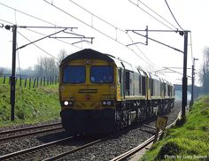 ' Class 66597 leads 66 596 , 66 957 and 66 539 northwards from 'Crewe to Carlisle at 'Woodacre' , Saturday April 2017 . Photo by Gary Severn . British Rail, Diesel Locomotive, Bahn, Carlisle, Sheds, North West, Planes, Transportation, Random Stuff
