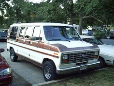 1989 Ford Econoline 150 Conversion Van (my 5th vehicle, & my husband & my 2nd vehicle together. Ours was maroon. Had limo track lights along the ceiling, shag carpet & a built in drink cooler. Bought it as a camping/road trip mobile & ended up using it for our carpet installation business. Was a great old van. Had it for about 10 years. My husband also had this in solid gray, as a cargo van for work, when we were in our mid 20's. ~Cindy M.)