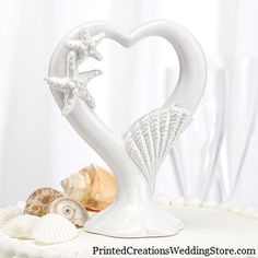 The Starfish Cake Top will complement any beach theme wedding cake. Made from porcelain, this cake top is carved with a glittering seashell and starfish. Beach Cake Topper, Beach Wedding Cake Toppers, Wedding Topper, Wedding Cakes, Wedding Favors, Wedding Reception, Wedding Supplies, Party Supplies, Party Favors