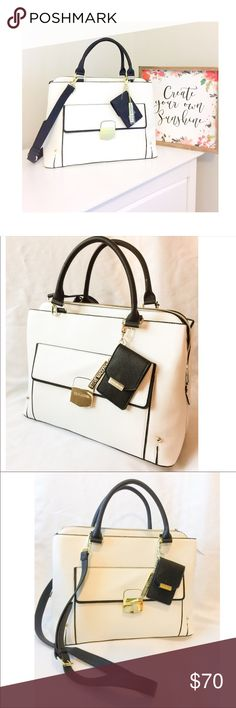 New Steve Madden Black & White Satchel with Strap! Classic design with an elegant & modern appearance, this Steve Madden bag provides lots of room for our everyday outings. It has 3 compartments of which 2 have a magnetic closure;the 3rd one is in the middle & it has a zipper closure.The interior of this compartment has 2 slide pockets & a zippered pocket. The exterior has a smaller compartment with a magnetic closure.  The strap is adjustable AND removable. Plus, it has a card holder (which…
