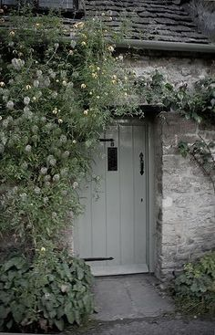 door Small Soft shades of gray repeated in the cottage colors and . the flowers clamoring up the doorway.Soft shades of gray repeated in the cottage colors and . the flowers clamoring up the doorway. Cottage Front Doors, Cottage Door, Cottage Exterior, Cozy Cottage, Cottage Living, Cottage Homes, White Cottage, Country Front Door, Cottage Entryway