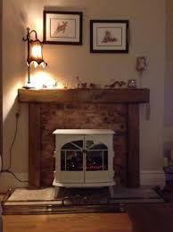 oak beam over white fire surround Oak Mantle, Faux Fireplace Mantels, Stove Fireplace, Fireplace Surrounds, Fireplace Design, Farmhouse Fireplace, White Fire Surround, Wood Stove Surround, Wooden Fireplace Surround