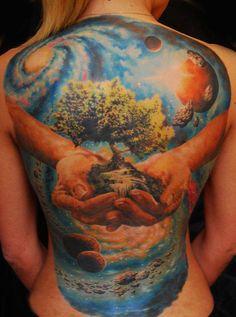 Universum full back tattoo