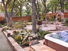 Spectacular patio with waterfall, raised beds, hot tub, seat wall. Looks like it handled several challenges beautifully.