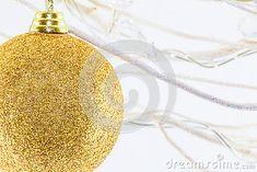 A close up of a gold glittery Christmas globe