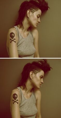 Shes so cool :D The tattoo, the hair and the piercing!