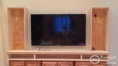 """This is my DIY  Built In / Wall Unit made for 60"""" TV. I used three in stock brown maple Home Depot upper kitchen cabinets (30"""" wide x 18""""..."""