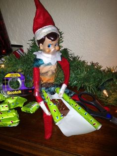Elf is wrapping mini gifts....Help with Elf | Voted to most unique elf ideas on the web