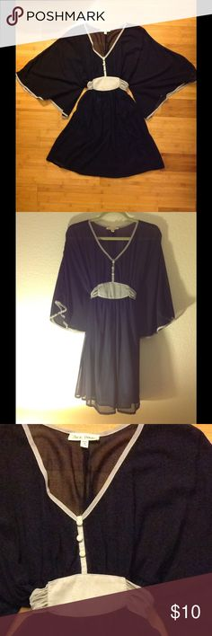 🦋ButterFly Dress🦋 Want to get away?!? Fly away in this sweet n' romantic navy blue dress with silver belt for shape... sits right above the knees, can be worn with tights for extra comfort. Wore 1x with chestnut high-heel boots 😉. Great conditions. Hot & Delicious  Dresses Mini
