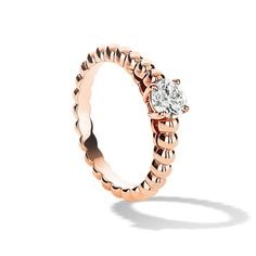 Perlée solitaire - Pink Gold, Diamond.  Playful and refined, the pure lines of the Perlée collection are on ode to contemporary elegance.  The soft contours of this timeless ring are adorned with a dazzling diamond, available in 4 carat weights, from 0.30ct to 1.00ct. - From $4,000.