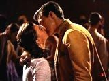 """West Side Story"" (1961)--From across the dance floor, Puerto Rican Maria (Natalie Wood) and Polish-American Tony (Richard Beymer) spotted each other and became magically entranced, drawn to each other as other couples around them froze--it was instantaneous love at first sight; the camera slowly moved in as Tony's lips descended to Maria's for their first kiss"