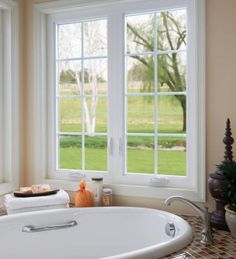 White Bathroom Windows In Cat Style With Colonial Grids View Our Photo Gallery For More Inspirational Window Ideas