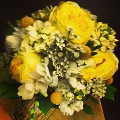 Yellow and White Bride Bq.  Yellow garden roses, yellow billy balls, white and yellow stock and wax flower, white freesia and salal leaves to finish it off.