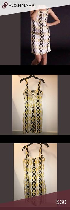 J. Crew Yellow & White Link Dress Cute silk yellow, black and white link print dress with pockets. Super comfortable and perfect with a pair of neutral or white wedges or sandals.  Small very light stain on the front of the dress towards the bottom hem. J. Crew Dresses Midi