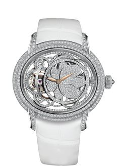 "Hand-wound watch with tourbillon. 18-carat white gold case, entirely set with diamonds. 18-carat white gold dial. Snow-set flower, pink gold hands. ""Large square scale"" pearly white alligator strap. 424 brilliant-cut diamonds ; ~3.95 carats (case, buckle). 504 brilliant-cut diamonds ; ~1.12 carats (flower, rings). 213 brilliant-cut diamonds ; ~0.25 carats (movement)."