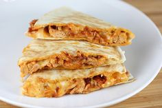 Chicken Tinga Quesadillas Recipe | BlogChef.net      2 tablespoons olive oil     1 large onion (cut into rings)     1 (15 ounce) can stewed tomatoes     1 (7 ounce) can chipotle peppers in adobo sauce (or to taste)     2lbs boneless skinless chicken breasts     8 (10 inch) flour tortillas     3 cups shredded Mexican cheese blend     butter (for spreading)