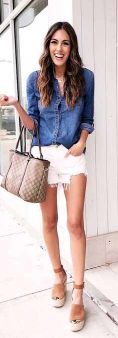 #spring #outfits woman in blue denim long-sleeved shirt and white shorts. Pic by @stylethegirl