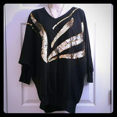 Vintage 80' Sweatshirt Get your bling on with this Dollman Style black sweatshirt.  Would fit a size  M/L (10/12). Or Go oversize if you are  size S. ;)  50% Polyester  50% Cotton Sweaters