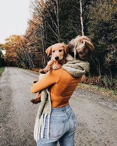 Fall colored mustard/orange top, light wash blue jeans, wrap around scarf and of course a puppy to top off the look